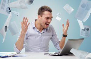 stress and frustration at work, throwing papers