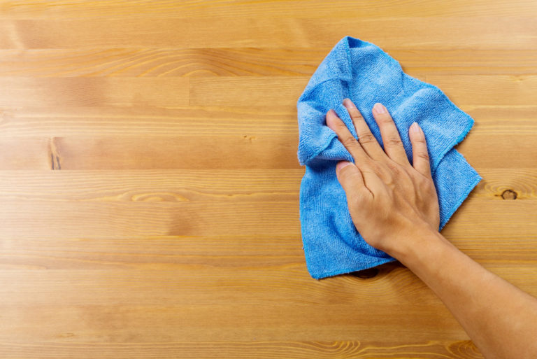 wiping a wooden floor